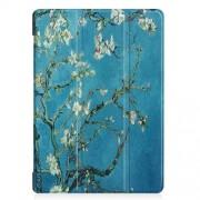 Δερμάτινη Θήκη Βιβλίο Tri-Fold με Βάση Στήριξης για Lenovo Tab E10 - Ανθισμένα Κλαδιά σε Μπλε Φόντο